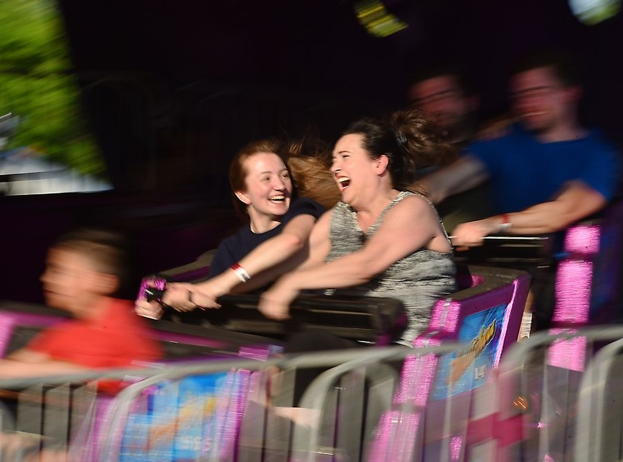 Shelly Banks looks at her mother, Martha, as they hang on to the spinning Matterhorn ride during last year's Glendale Heights Fest.