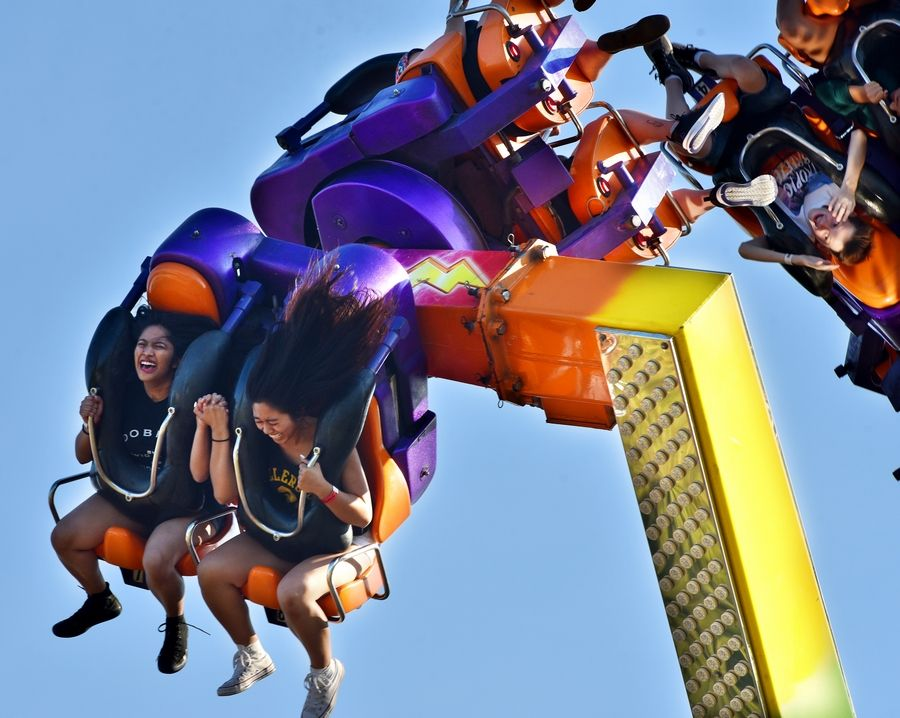 Riders laugh on the Power Surge during last year's Glendale Heights Fest.