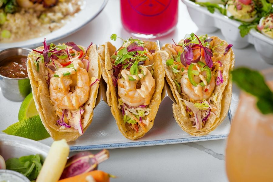 The Hampton Social serves fresh seafood dishes, including shrimp tacos.