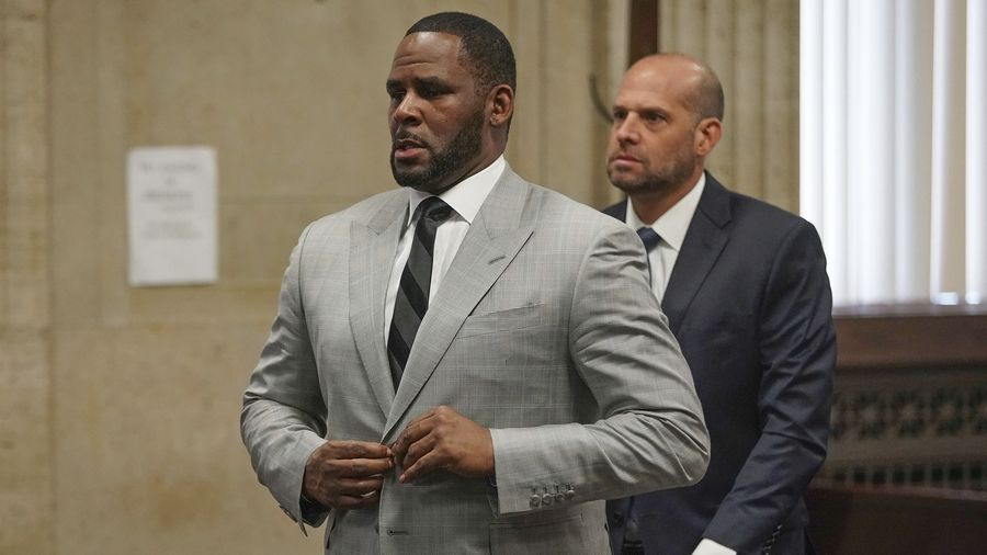 FILE -- In this June 6, 2019, file photo, singer R. Kelly pleaded not guilty to 11 additional sex-related felonies during a court hearing before Judge Lawrence Flood at Leighton Criminal Court Building in Chicago. R. Kelly, already facing sexual abuse charges brought by Illinois prosecutors, was arrested in Chicago Thursday, July 11, 2019 on a federal grand jury indictment listing 13 counts including sex crimes and obstruction of justice.