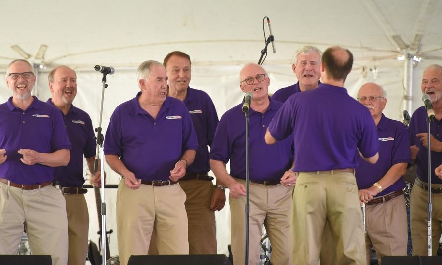 The Arlingtones men's a cappella chorus performs on the first night of Itasca Fest Thursday.
