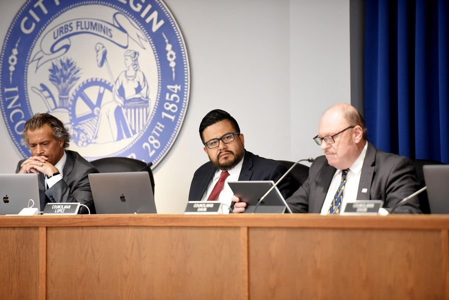 Elgin City Councilman Baldemar Lopez, center, said Wednesday the city should do a disparity study, which looks at whether cities have practices that exclude businesses owned by women, veterans or minorities from getting contracts.