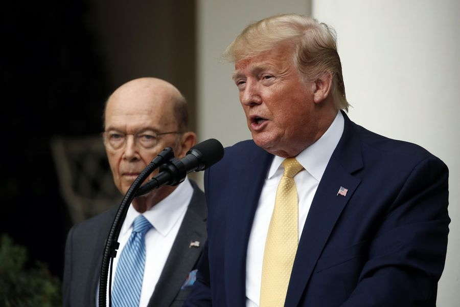 President Donald Trump is joined by Commerce Secretary Wilbur Ross as he speaks in the Rose Garden at the White House in Washington, Thursday, July 11, 2019.