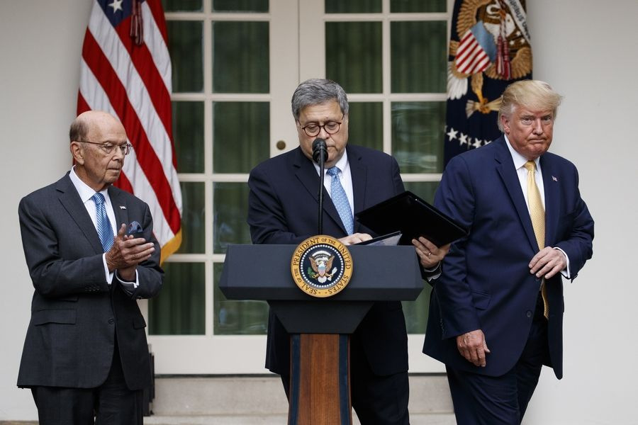 President Donald Trump, joined by Commerce Secretary Wilbur Ross, and Attorney General William Barr, participate in an event about the census and the citizenship question in the Rose Garden at the White House in Washington, Thursday, July 11, 2019.