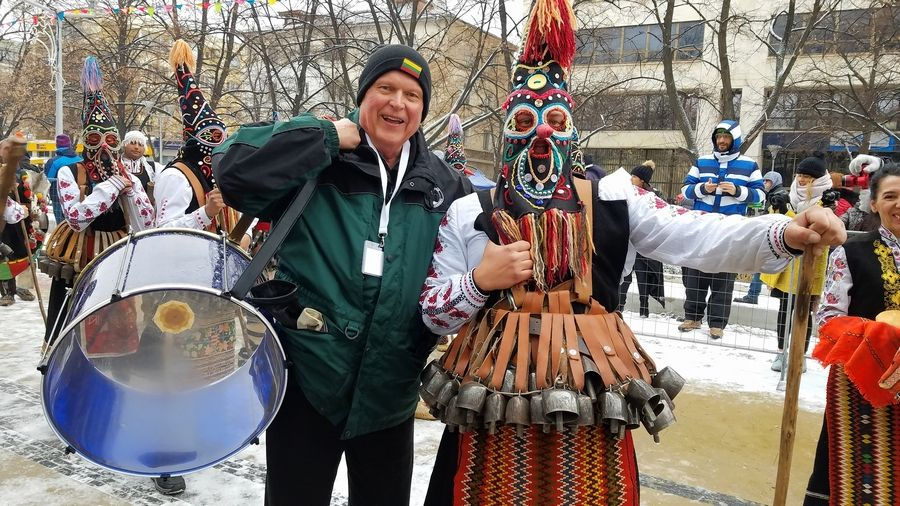 Elk Grove Village Trustee Pat Feichter, from left, poses with a costumed folk performer during the Surva festival in Pernik, Bulgaria, in January.