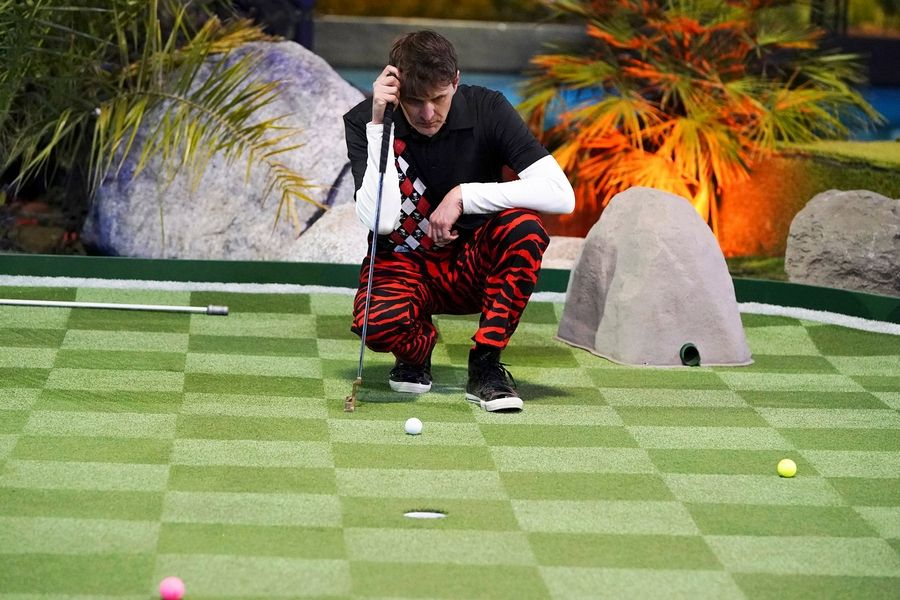 "Mick Cullen, instructor of human services at the College of Lake County in Grayslake and an avid mini-golf enthusiast, sizes up a putt on ""Holey Moley,"" the new mini-golf-themed competitive series on ABC-TV."