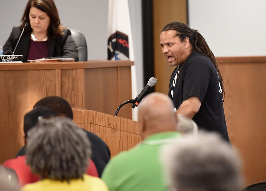 Activist Marcus Banner of Elgin speaks to the Elgin City Council Wednesday after the release of a report saying police Lt. Christian Jensen followed policy on use of deadly force when he shot Decynthia Clements.