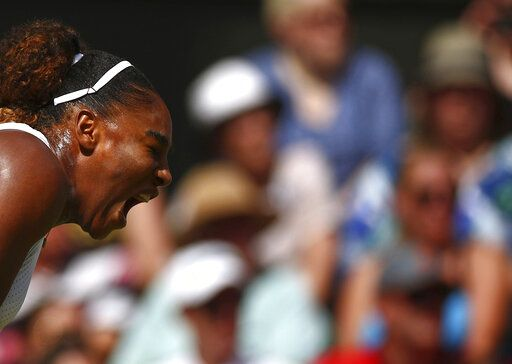 United States' Serena Williams reacts as she plays Czech Republic's Barbora Strycova in a Women's semifinal singles match on day ten of the Wimbledon Tennis Championships in London, Thursday, July 11, 2019. (Hannah McKay/Pool Photo via AP)