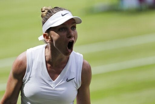 Romania's Simona Halep celebrates winning a point against Ukraine's Elina Svitolina in a Women's semifinal singles match on day ten of the Wimbledon Tennis Championships in London, Thursday, July 11, 2019.
