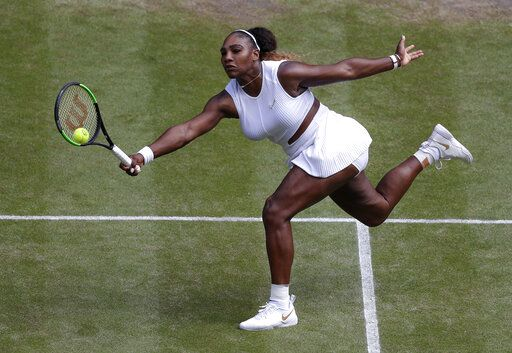 United States' Serena Williams returns to Czech Republic's Barbora Strycova during a women's singles semifinal match on day ten of the Wimbledon Tennis Championships in London, Thursday, July 11, 2019.