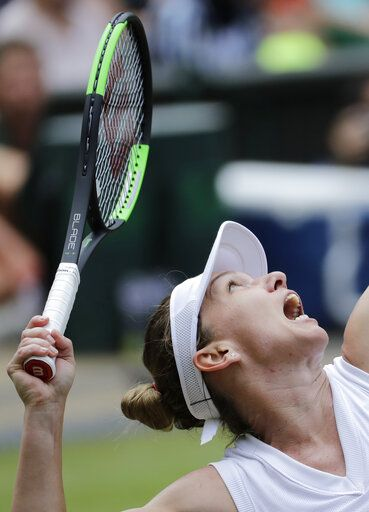 Romania's Simona Halep serves to Ukraine's Elina Svitolina in a Women's semifinal singles match on day ten of the Wimbledon Tennis Championships in London, Thursday, July 11, 2019.