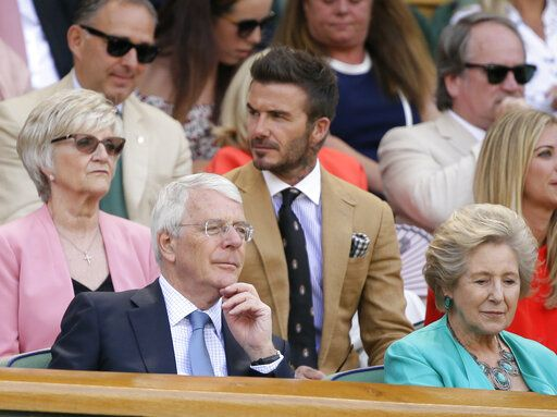 Former British Prime Minister John Major, left, his wife Norma, former British footballer David Beckham, center top, sit in the Royal Box on Centre Court on day ten of the Wimbledon Tennis Championships in London, Thursday, July 11, 2019.