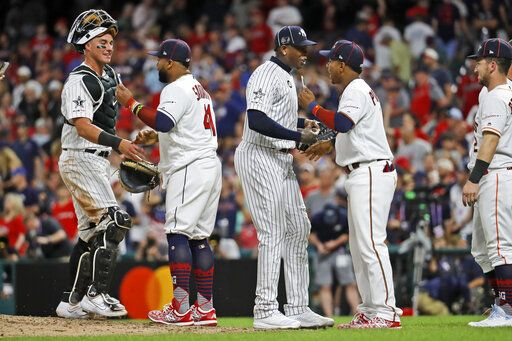 Members of the American League squad celebrate their 4-3 victory over the National League in the MLB baseball All-Star Game, Tuesday, July 9, 2019, in Cleveland.