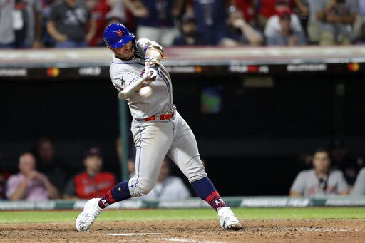 National League's Pete Alonso, of the New York Mets, hits a two run single during the eighth inning of the MLB baseball All-Star Game against the American League, Tuesday, July 9, 2019, in Cleveland.