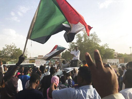Sudanese people celebrate in the streets of Khartoum after ruling generals and protest leaders announced they have reached an agreement on the disputed issue of a new governing body on Friday, July 5, 2019.   The deal raised hopes it will end a three-month political crisis that paralyzed the country and led to a violent crackdown that killed scores of protesters.