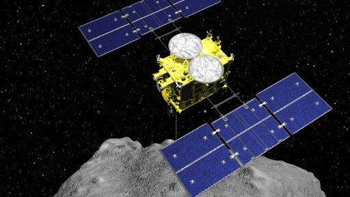 FILE - This computer graphics image released by the Japan Aerospace Exploration Agency (JAXA) shows the Hayabusa2 spacecraft above the asteroid Ryugu. Japan's space agency JAXA said Thursday, July 11, 2019 that data transmitted from the Hayabusa2 indicated its second successful touchdown on the distant asteroid to complete a historic mission - to collect underground samples in hopes of finding clues to the origin of the solar system. (ISAS/JAXA via AP)