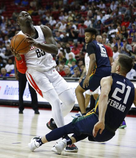 Houston Rockets' Rawle Alkins, left, drives into Utah Jazz's Frankie Ferrari during the first half of an NBA summer league basketball game Thursday, July 11, 2019, in Las Vegas.