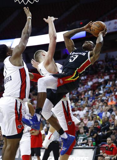 Atlanta Hawks' Thomas Wimbush, right, is fouled by Washington Wizards' Jemerrio Jones during the second half of an NBA summer league basketball game Thursday, July 11, 2019, in Las Vegas.