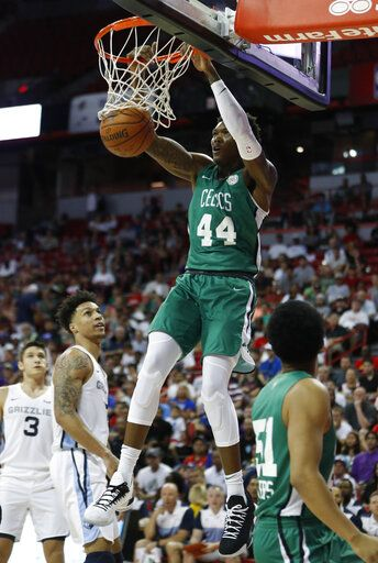 Boston Celtics' Robert Williams dunks against the Memphis Grizzlies during the first half of an NBA summer league basketball game Thursday, July 11, 2019, in Las Vegas.