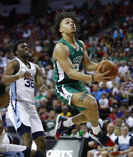 Boston Celtics' Carsen Edwards shoots around Memphis Grizzlies' Keenan Evans during the first half of an NBA summer league basketball game, Thursday, July 11, 2019, in Las Vegas.