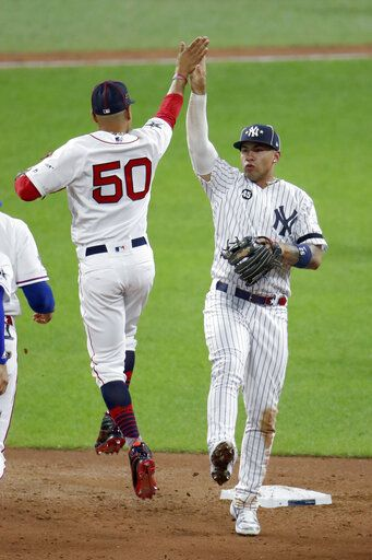 American League's Gleyber Torres, of the New York Yankees, and Mookie Betts (50), of the Boston Red Sox, celebrate the American League's 4-3 victory over the National League in the MLB baseball All-Star Game, Tuesday, July 9, 2019, in Cleveland.