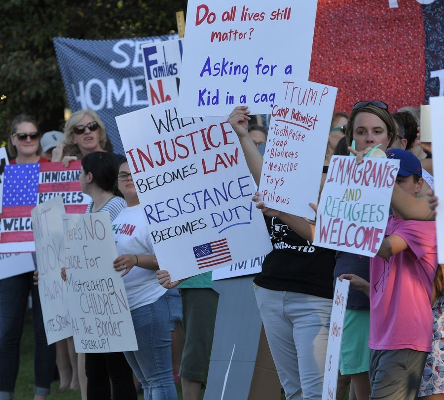 "Supporters of a ""Lights for Liberty"" vigil came 200 strong and lined up along Northwest Highway in Arlington Heights to protest the conditions faced by migrants near the southern U.S. border."