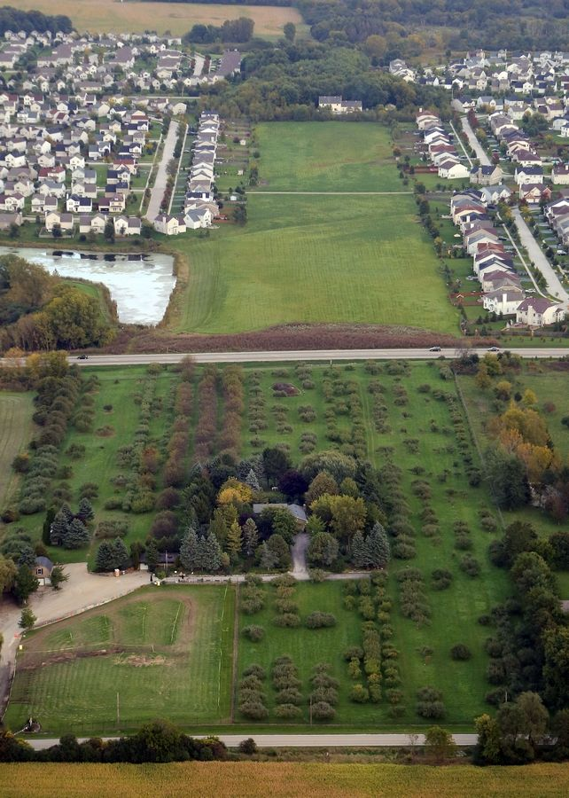 Land reserved for a Route 53 extension bisects housing developments near Round Lake.