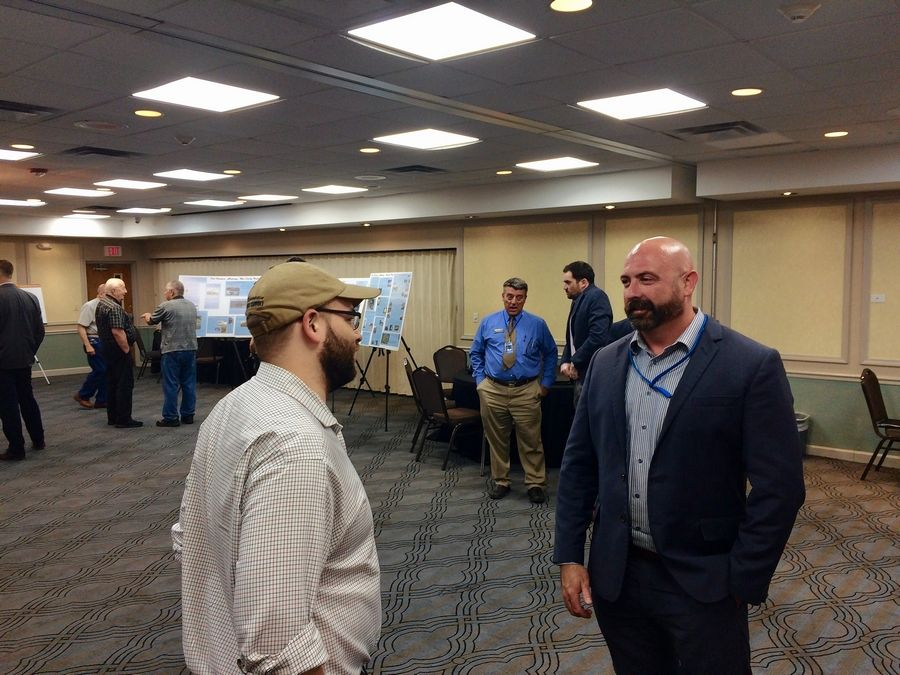 Jamie Abbott, right, who heads Chicago Executive Airport, attended an open house to collect more public input for the facility's master plan process Thursday night at Ramada Plaza by Wyndham Chicago North Shore in Prospect Heights.
