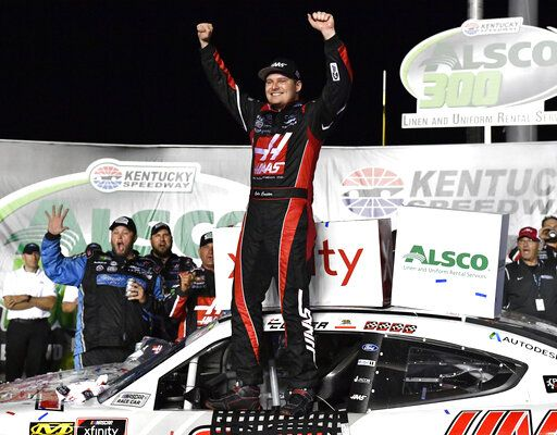 Cole Custer raises his hands in victory following the NASCAR Xfinity Series auto race at Kentucky Speedway in Sparta, Ky., Friday, July 12, 2019.