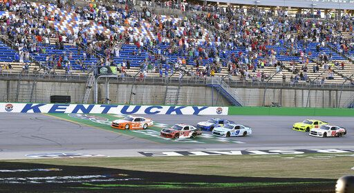 Austin Cindric (22) leads the field across the line at the start of the NASCAR Xfinity Series auto race at Kentucky Speedway in Sparta, Ky., Friday, July 12, 2019.