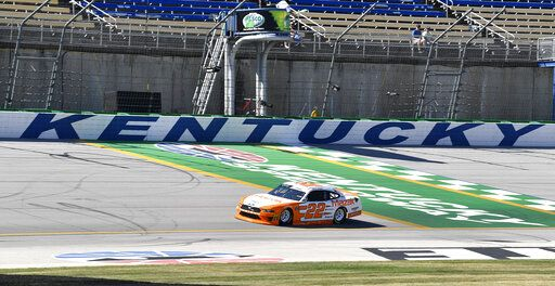 Austin Cindric (22) crosses the finish line to take the pole for an Xfinity Series auto race at Kentucky Speedway in Sparta, Ky., Friday, July 12, 2019.