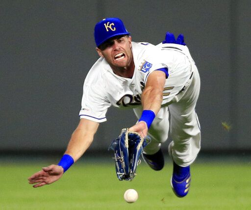 Kansas City Royals center fielder Bubba Starling fails to catch a fly ball hit by Detroit Tigers' Victor Reyes during the fifth inning of a baseball game at Kauffman Stadium in Kansas City, Mo., Friday, July 12, 2019. It was an RBI-double for Reyes on the play.