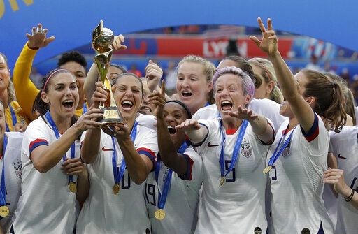 United States' team celebrates with trophy after winning the Women's World Cup final soccer match between US and The Netherlands at the Stade de Lyon in Decines, outside Lyon, France, Sunday, July 7, 2019.