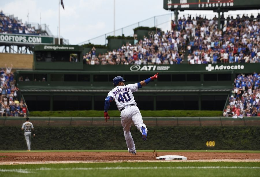 Chicago Cubs' Willson Contreras (40) gestures as he runs the bases after hitting a 3-run home run against the Pittsburgh Pirates during the first inning Saturday in Chicago.
