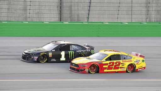 Kurt Busch (1) drives next to Joey Logano (22) during the NASCAR Cup Series auto race at Kentucky Speedway in Sparta, Ky., Saturday, July 13, 2019.