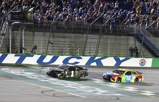 Kurt Busch crosses the finish line ahead of Kyle Busch (18) to win the NASCAR Cup Series auto race at Kentucky Speedway in Sparta, Ky., Saturday, July 13, 2019.