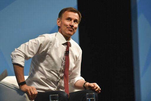 Conservative Party leadership candidate Jeremy Hunt gestures, during a Conservative Party leadership hustings in Cheltenham, England, Friday July 12, 2019. (Jacob King/PA via AP)