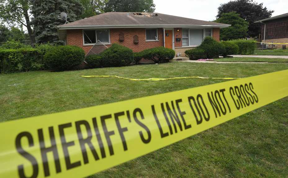 Authorities are investigating the background of an Elmhurst-area mother who shot and killed her two sons before turning the gun on herself.