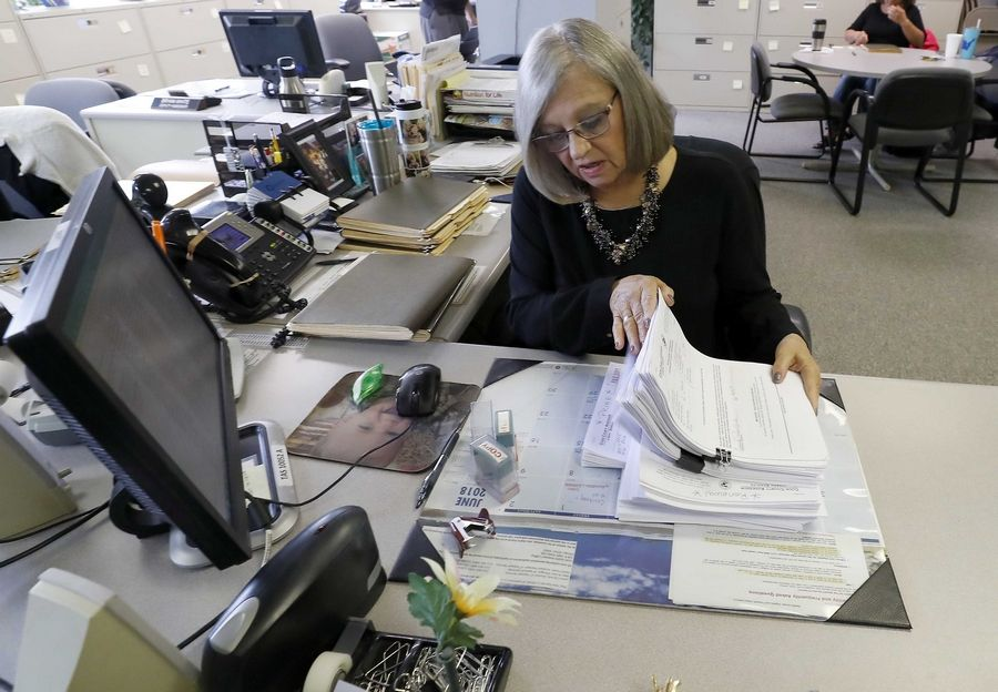 Laurie Wagner, chief deputy assessor for Elk Grove Township, dealt with hundreds of late senior exemption applications last year. Cook County officials said many senior homeowners did not reapply for discounts this year.