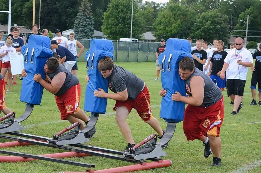 Batavia High School linemen compete in the sled-drive contest at the 2014 Battle of the Big Butts at West Aurora High School. Offensive and defensive Linemen from about 30 schools are expected for this year's battle on Thursday, July 18, at Ken Zimmerman Field.