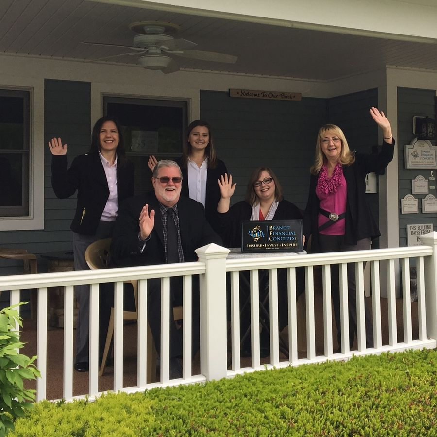 Brandt Financial Concepts President Carol Brandt, right, is joined by, from left, Kim Randall, Katie Stearney, Vice President Jim Brandt and Sarah Miller on the porch of their office in downtown Palatine.
