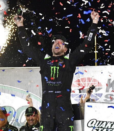 Kurt Busch celebrates his win in the NASCAR Cup Series auto race at Kentucky Speedway in Sparta, Ky., Saturday, July 13, 2019.