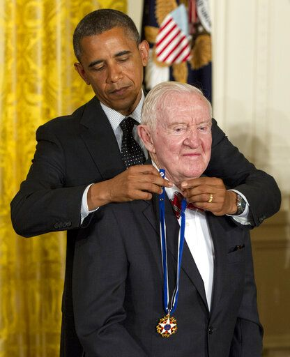 FILE - In this May 29, 2012 file photo, President Barack Obama awards former Supreme Court Justice John Paul Stevens the Presidential Medal of Freedom in the East Room of the White House, in Washington. Stevens, the bow-tied, independent-thinking, Republican-nominated justice who unexpectedly emerged as the Supreme Court's leading liberal, died Tuesday, July 16, 2019, in Fort Lauderdale, Fla., after suffering a stroke Monday. He was 99.