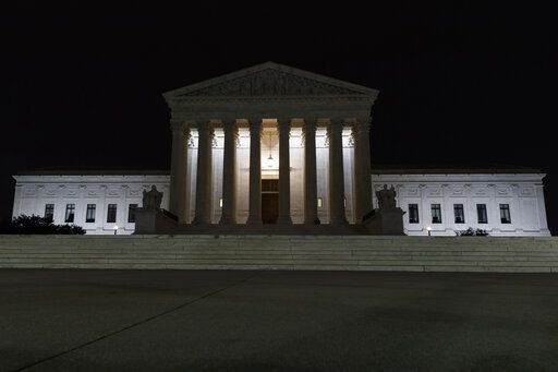 The Supreme Court is seen in Washington, late Tuesday, July 16, 2019. Former U.S. Supreme Court Justice John Paul Stevens died Tuesday in Fort Lauderdale, Fla., after suffering a stroke Monday. He was 99.