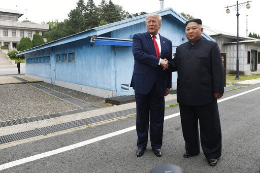 FILE - In this June 30, 2019, file photo, U.S. President Donald Trump, left, meets with North Korean leader Kim Jong Un at the border village of Panmunjom in the Demilitarized Zone, South Korea. North Korea on Tuesday, July 16, 2019, says it is rethinking whether to abide by its moratorium on nuclear and missile tests and other steps aimed at improving ties with the U.S.