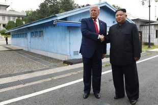 FILE - In this June 30, 2019, file photo, U.S. President Donald Trump, left, meets with North Korean leader Kim Jong Un at the border village of Panmunjom in the Demilitarized Zone, South Korea. North Korea on Tuesday, July 16, 2019, says it is rethinking whether to abide by its moratorium on nuclear and missile tests and other steps aimed at improving ties with the U.S. (AP Photo/Susan Walsh, File)
