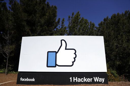 FILE - This March 28, 2018, file photo shows a Facebook logo at the company's headquarters in Menlo Park, Calif. Facebook's ambitious plan to create a new financial system based on a digital currency faces questions from lawmakers, as it's shadowed by negative comments from President Donald Trump, his Treasury secretary and the head of the Federal Reserve.