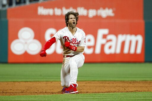 Philadelphia Phillies' Bryce Harper celebrates after hitting a game-winning two-run double off Los Angeles Dodgers relief pitcher Kenley Jansen during the ninth inning of a baseball game Tuesday, July 16, 2019, in Philadelphia. Philadelphia won 9-8.