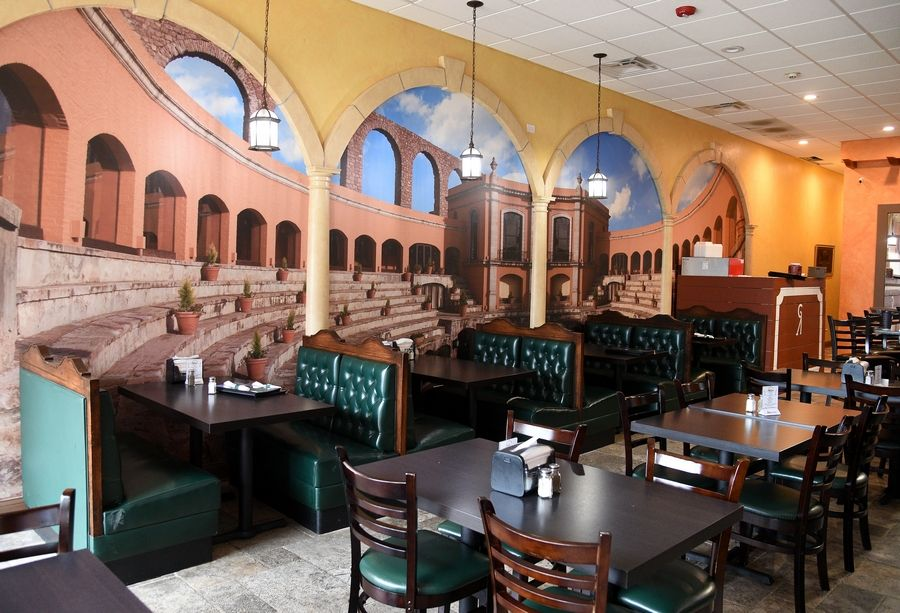 The stunning mural on the wall of Antigua Mexican Grill makes the Crystal Lake restaurant feel quite roomy.
