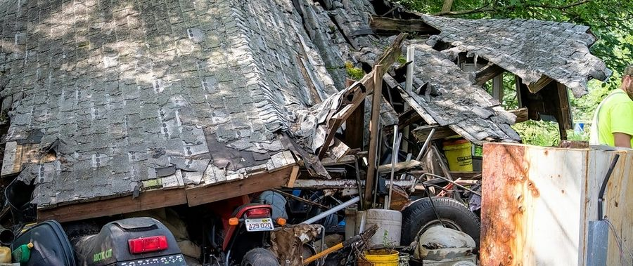 DuPage County works with property owners to repair or remove dilapidated or abandoned buildings in unincorporated areas through its Neighborhood Revitalization Program. Crews recently removed this garage, which had collapsed from neglect, from a home near Lombard.